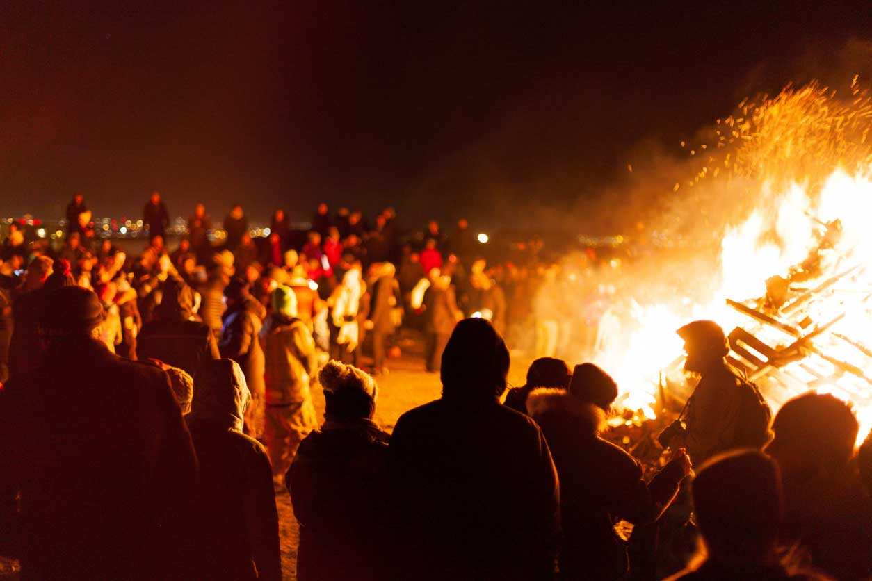 people around burning bonfire